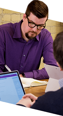 Photo of a Blueshift employee taking notes.