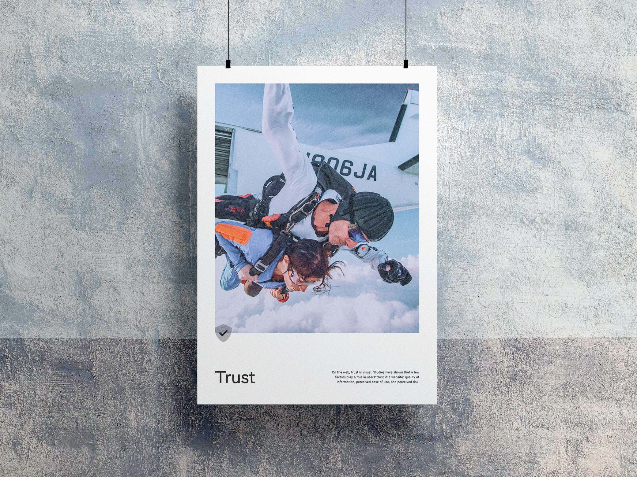 Trust poster with a man and woman skydiving