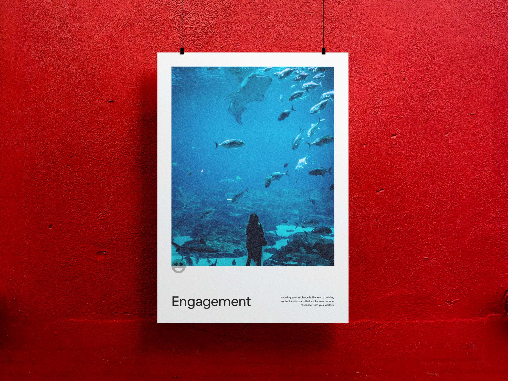 Engagement poster with an image of a young girl staring up at an aquarium tank with a shark and fish