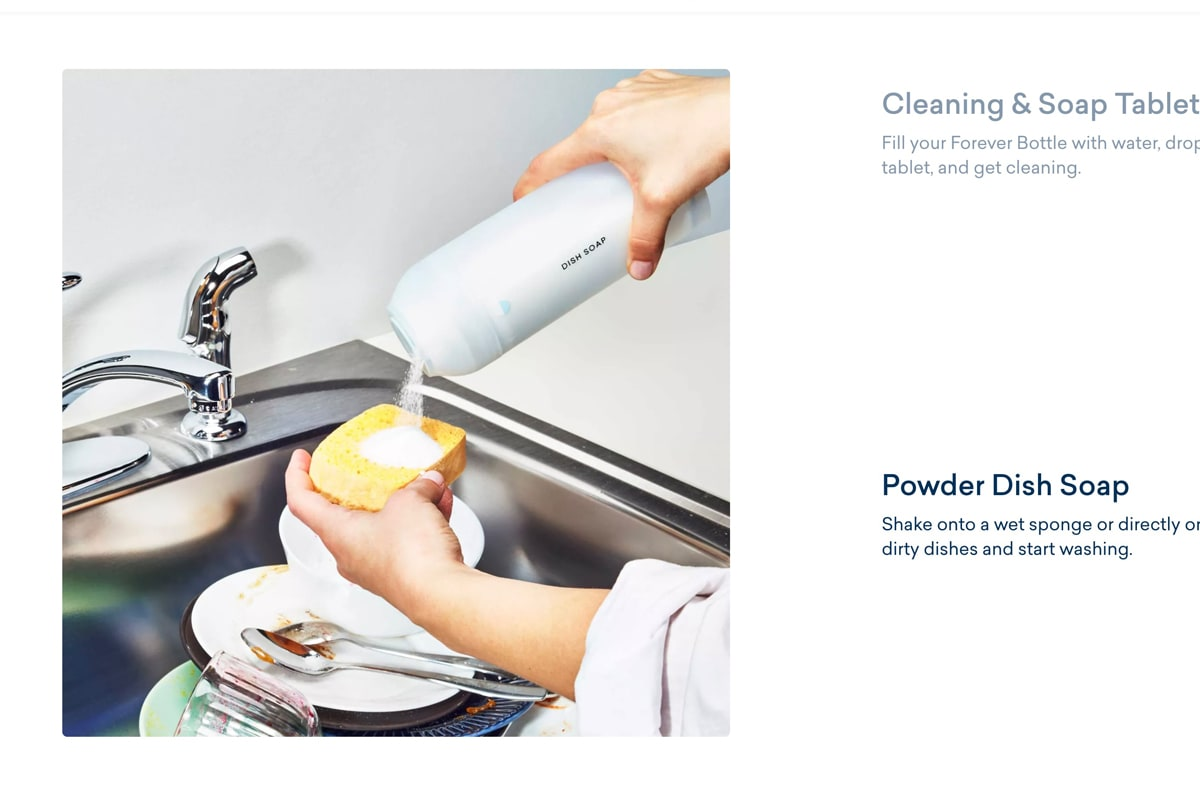 Blueland powder dish soap being poured on a sponge over a stainless steel sink full of dirty dishes