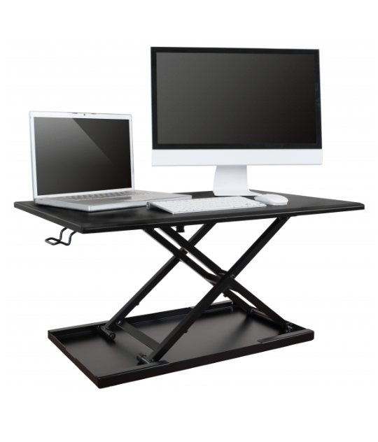 Standing desk converter with a laptop and computer screen on top