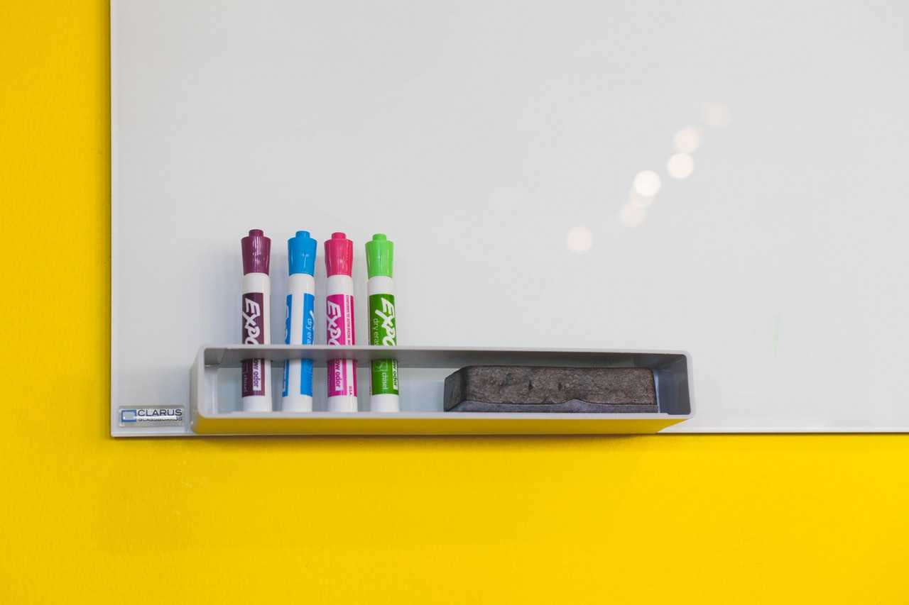 Another great desk organization ideas is a whiteboard to keep track of important deadlines!