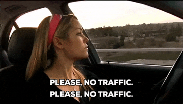 "Woman driving in a car with text ""please no traffic"""