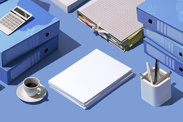 Office supplies ordered in an organized fashion over a desk top