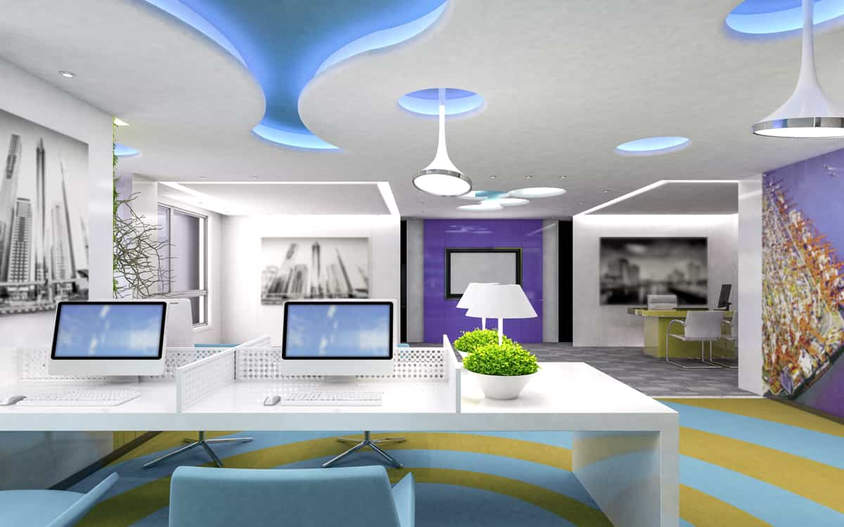 Open office space with two computers and bright accents for office decor