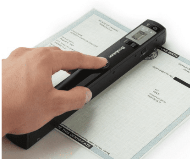 Hand holding a scanner overa document