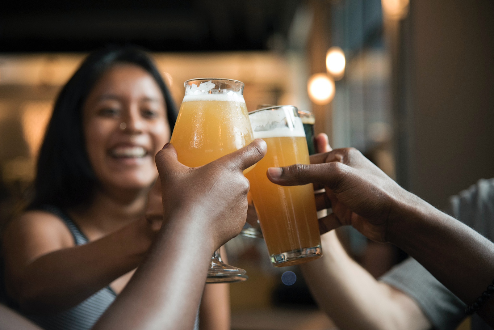 Coworkers enjoying cold beer as part of their employee stipends