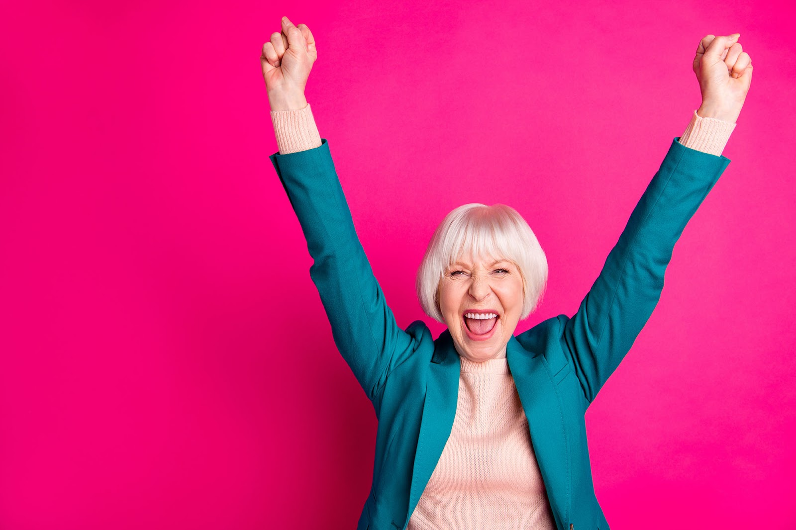 What is company culture? Happy older woman against a fuchsia background