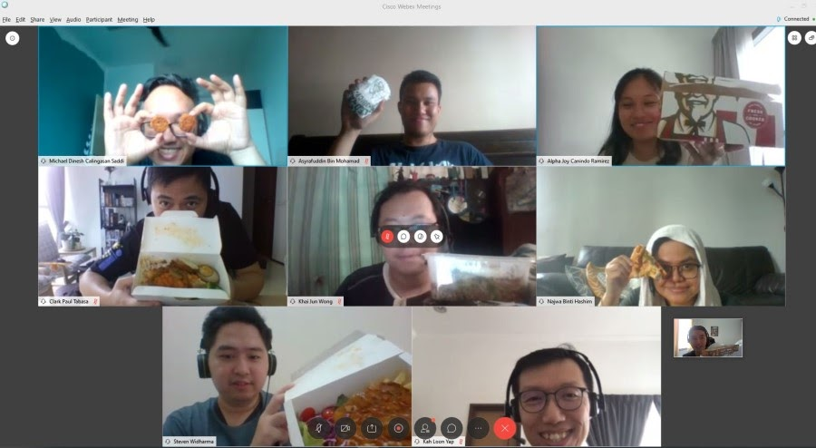 A screenshot of a virtual lunch with employees displaying their meal on screen