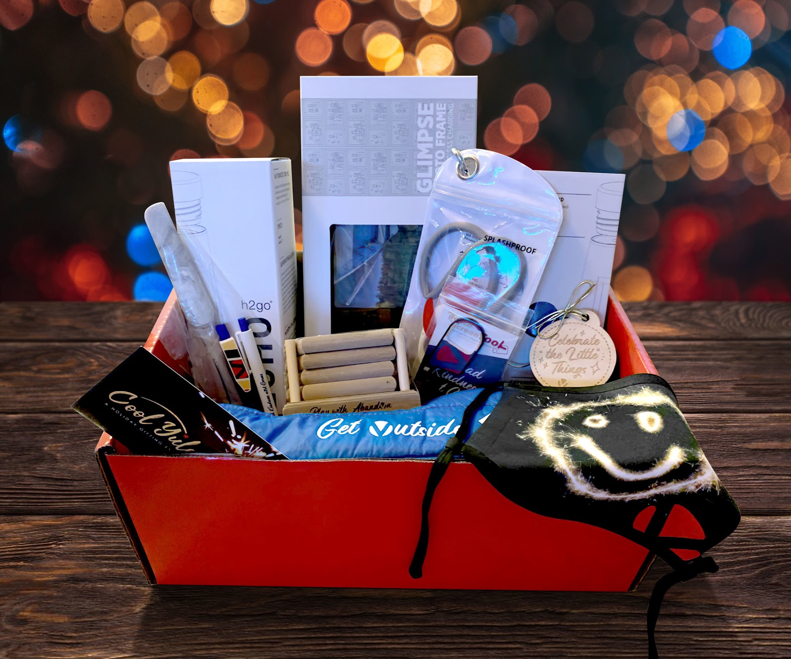 A photo of a event gift hamper with stationery, event aids, and an agenda