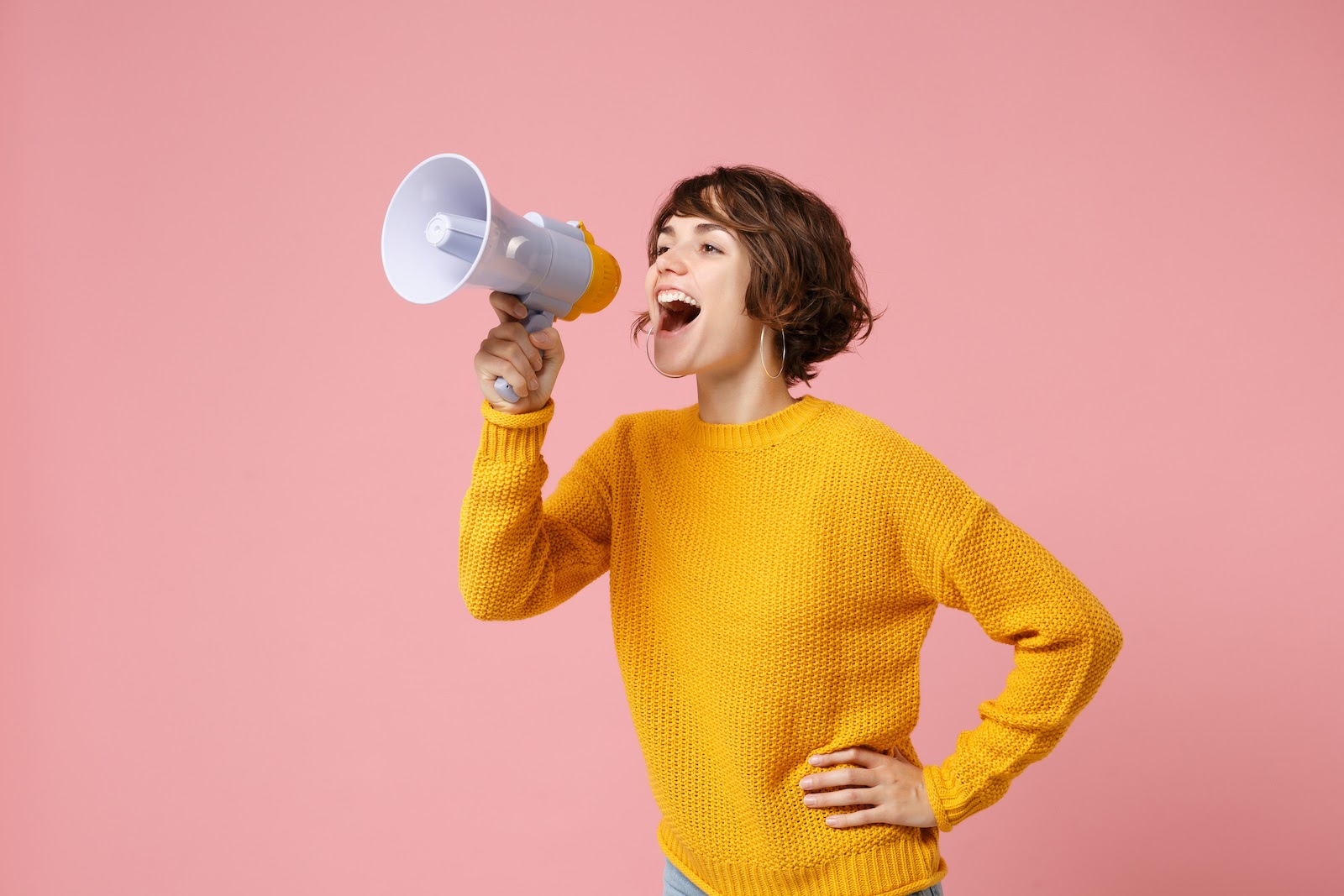 A woman holds a megaphone to symbolize event marketing initiatives