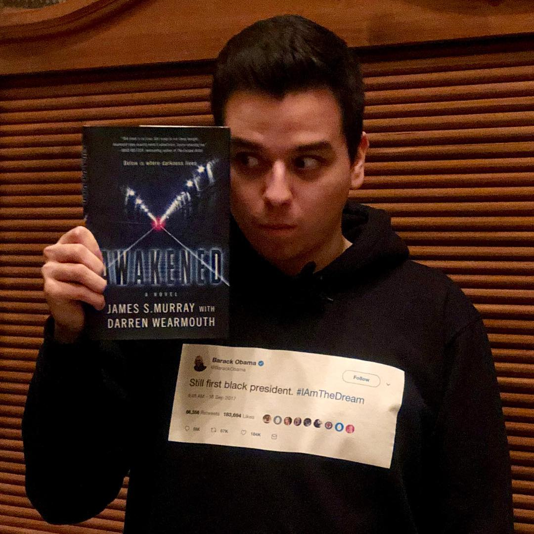 Hiram Nunez reading Awakened book by James S Murray from Impractical Jokers