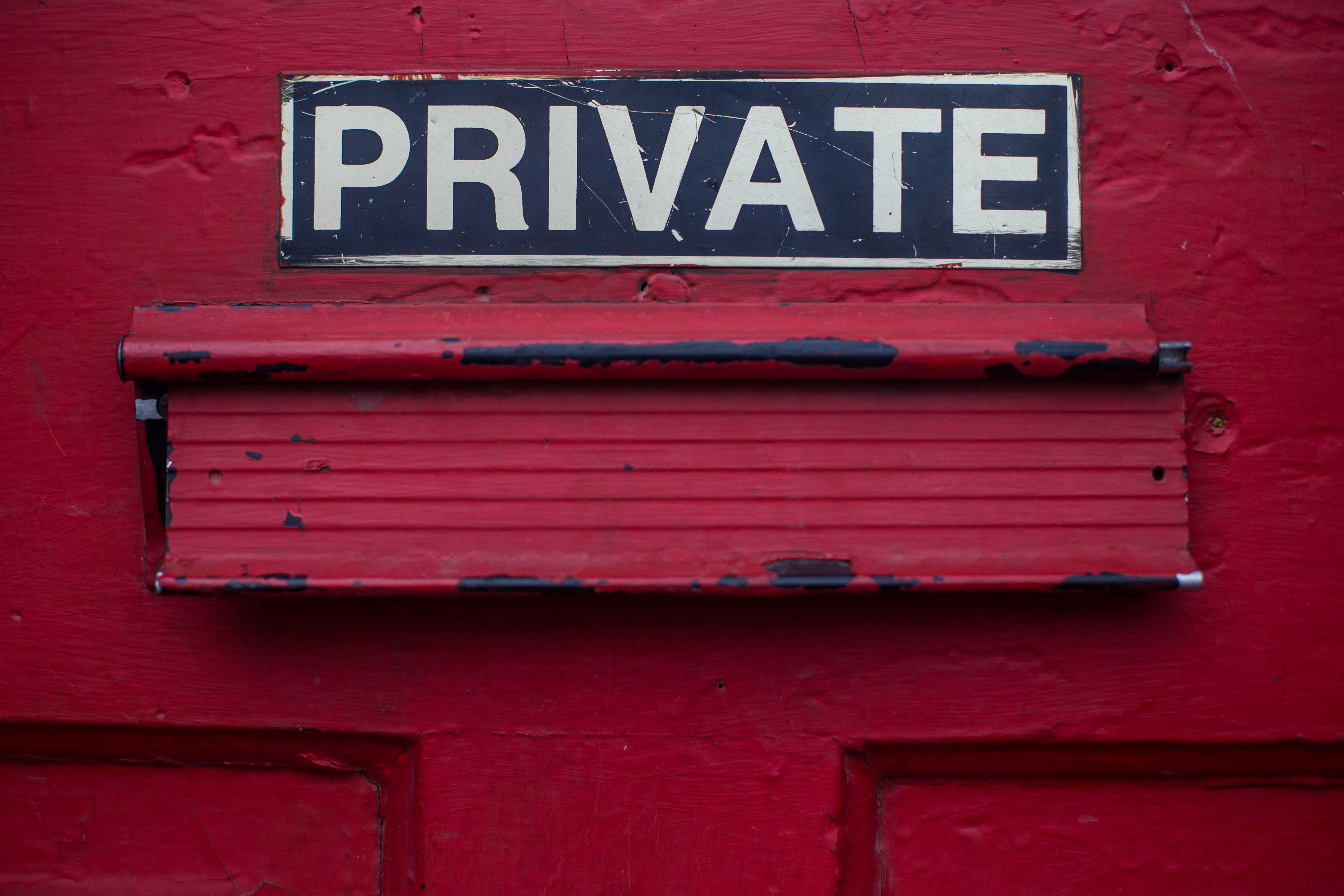 PRIVATE on red door