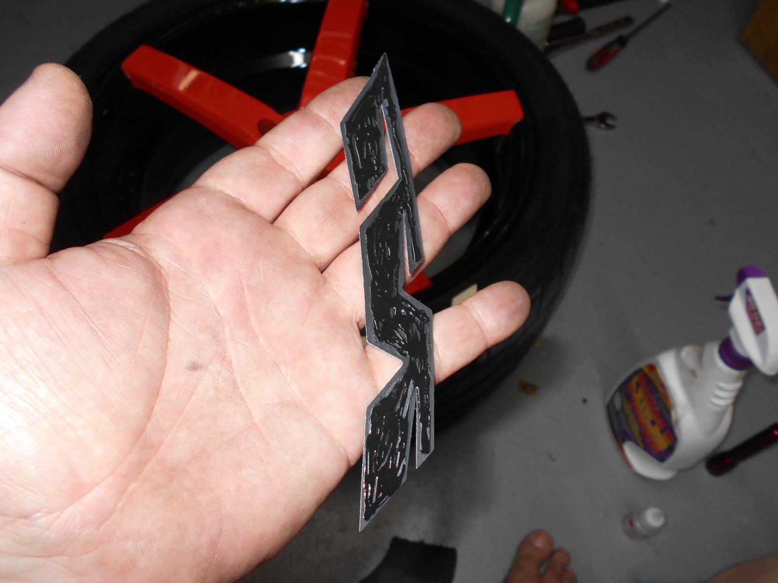applying adhesive to back of Treadwear graphics