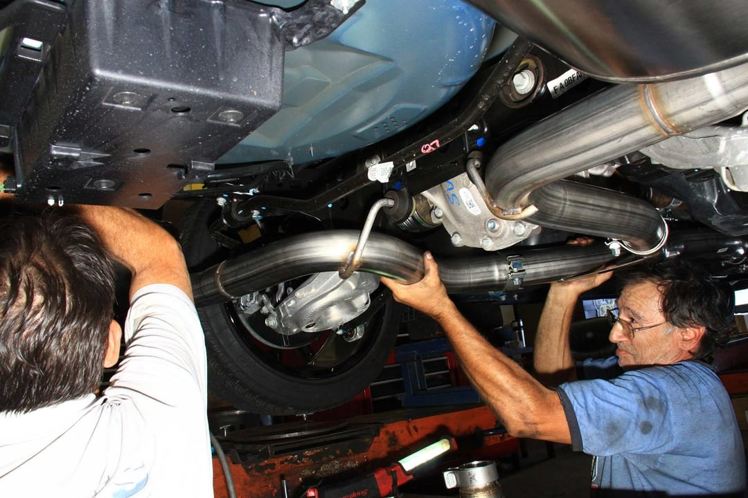 You're going to need a helper for your Corsa Performance system install,