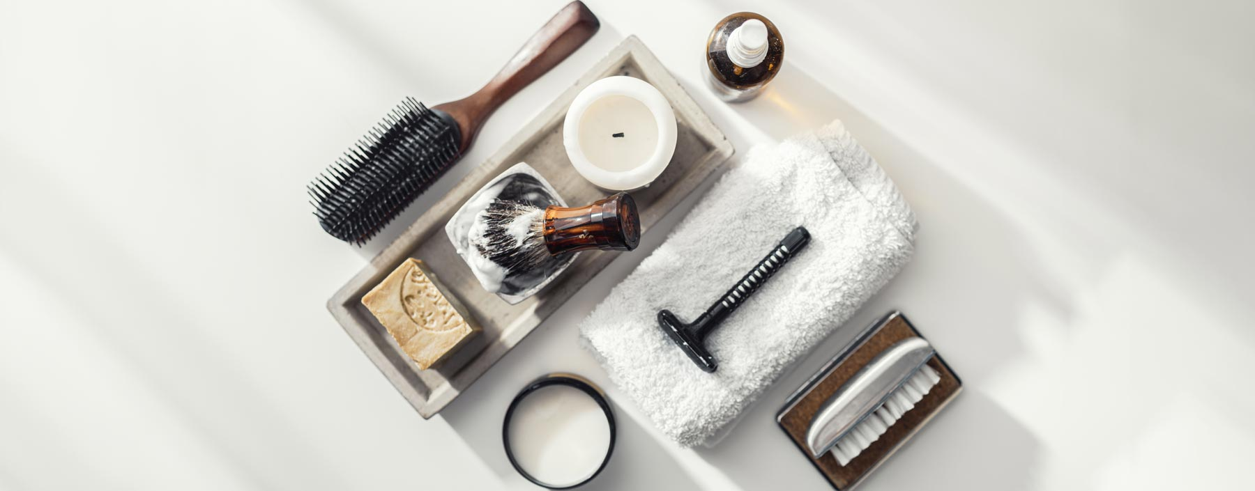 Flat lay of men's grooming tools. Razor, brush, soap, comb.