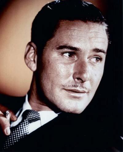Errol Flynn with his trademark pencil moustache