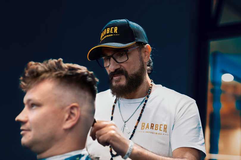 Barber Fadi Hamadeh cutting hair
