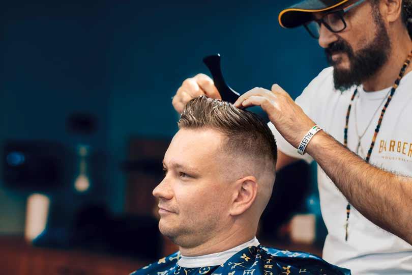 Barber combing hair