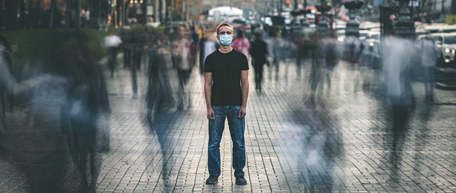 Man in Sydney street wearing mask - Coronavirus Lockdowns