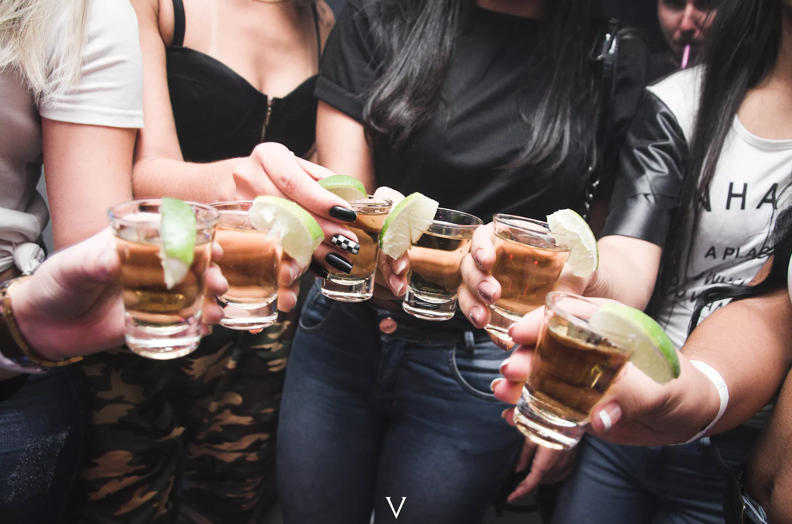 group of students drinking tequila