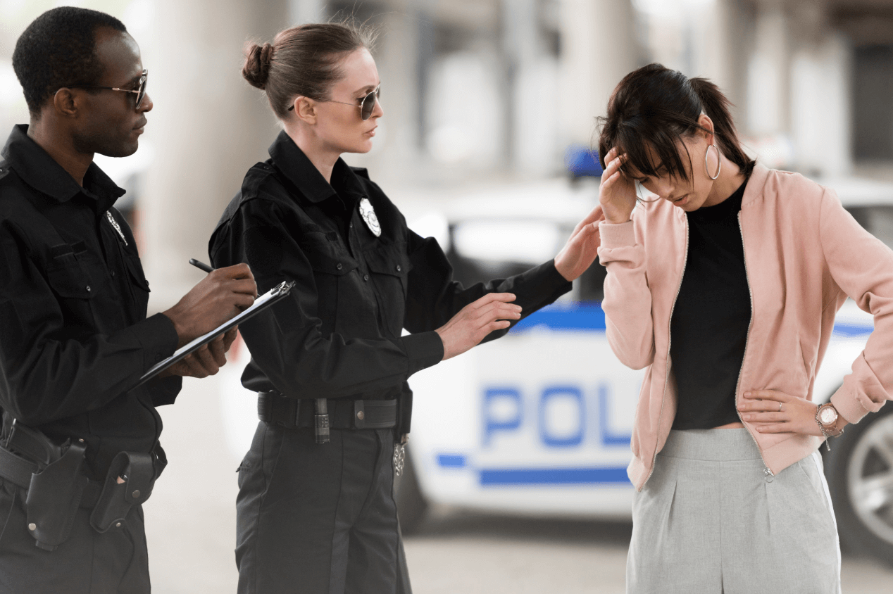 distressed woman talking to two police officers