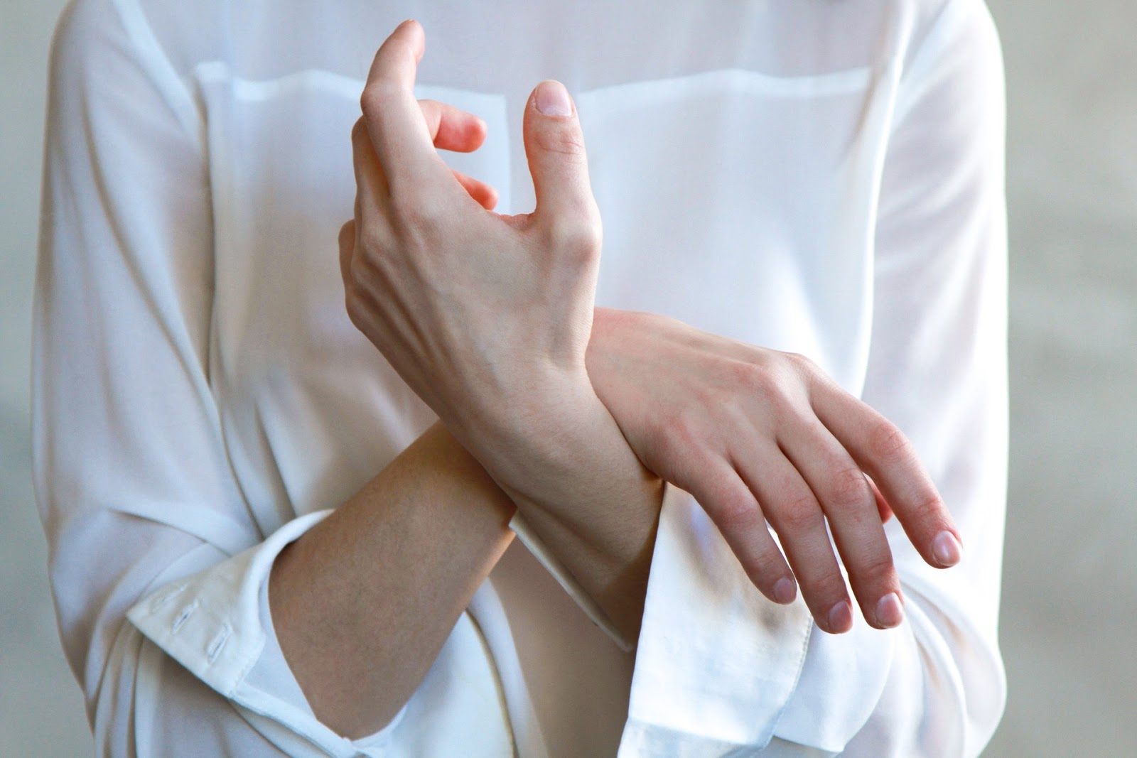 woman nervously holding hand