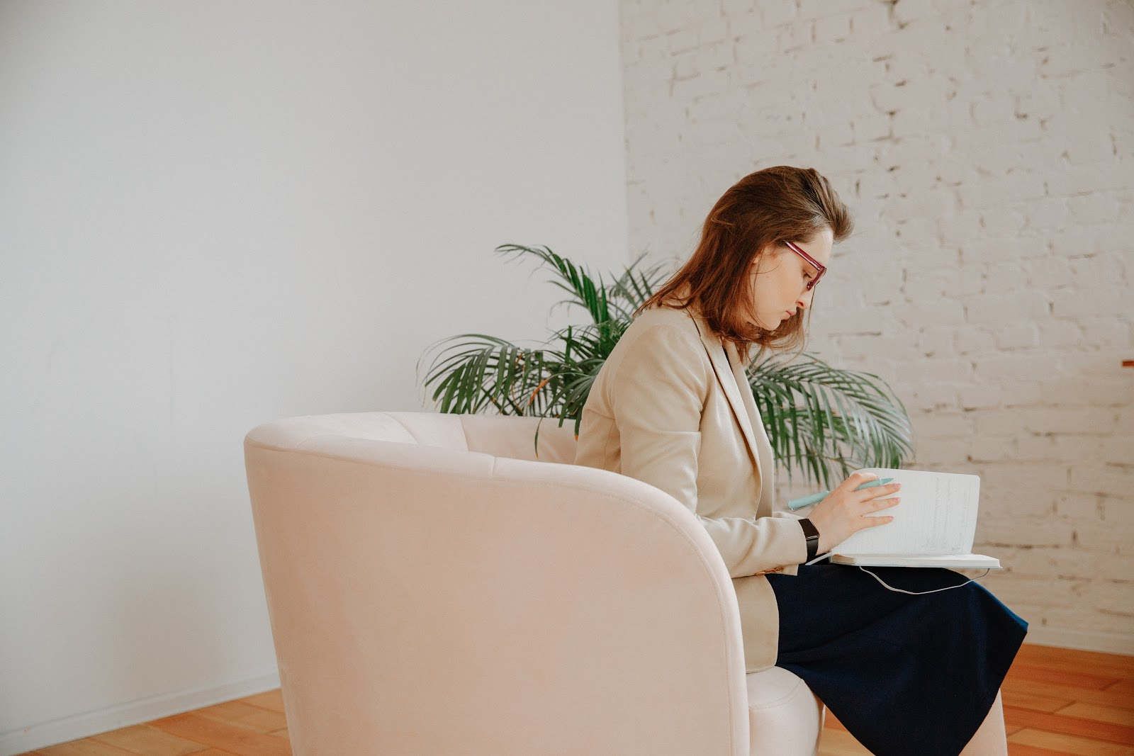 female therapist checking her notes