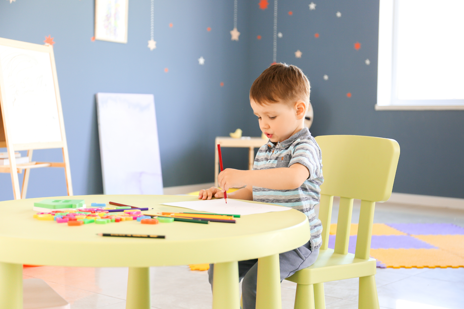 little boy with autism playing in a room