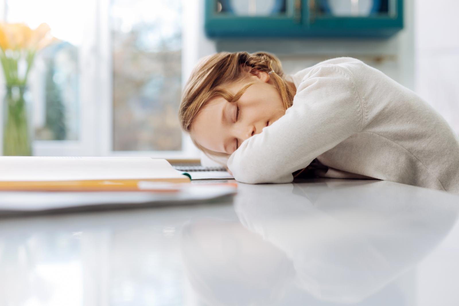 child fallen asleep at desk