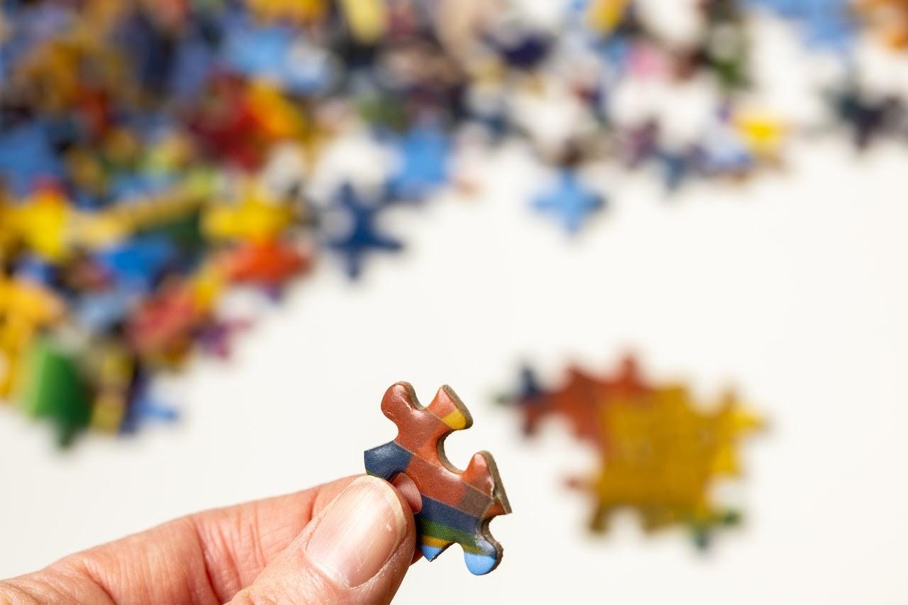 puzzle piece hand fingernail focus