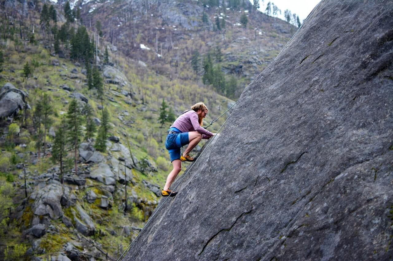 man rock climbing trees rock mountains altitude