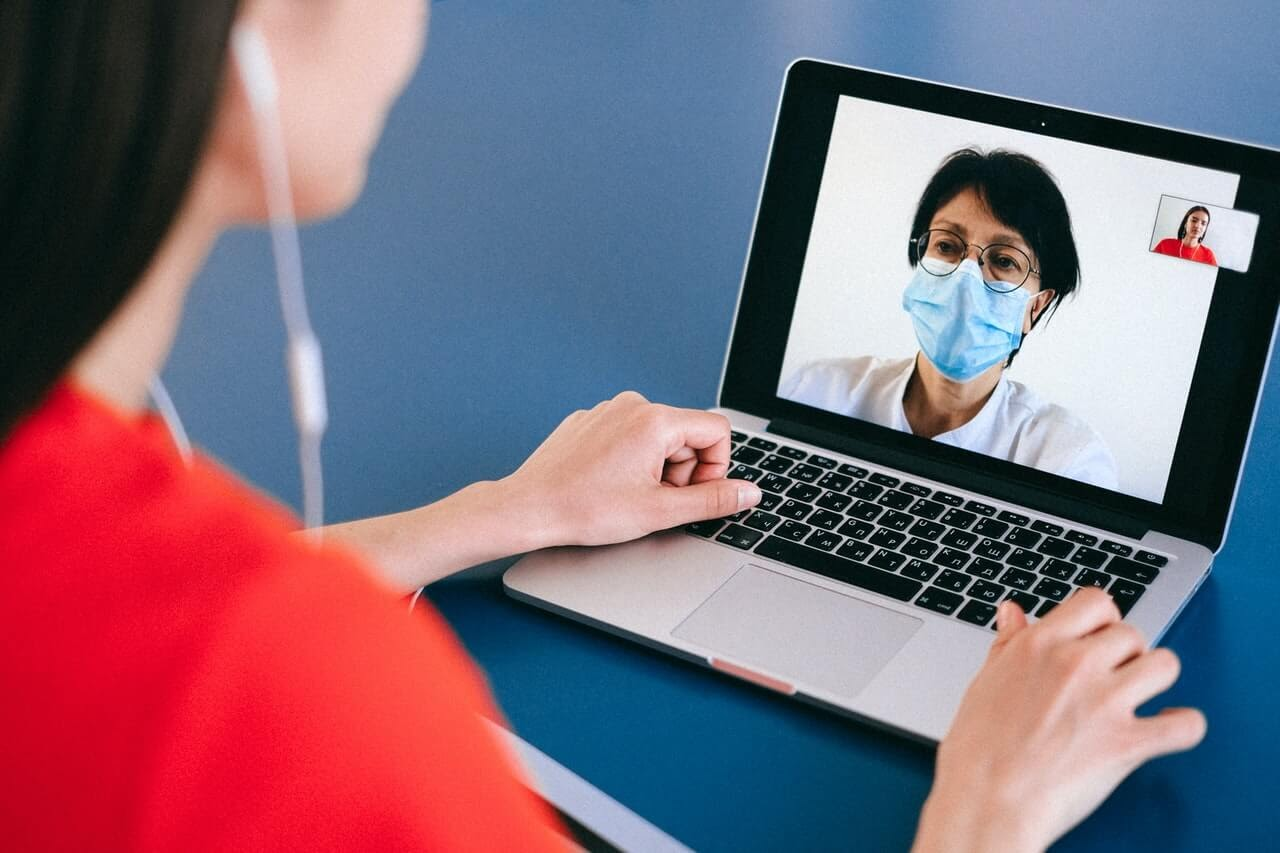 laptop doctor therapist teletherapy headphones appointment virtual