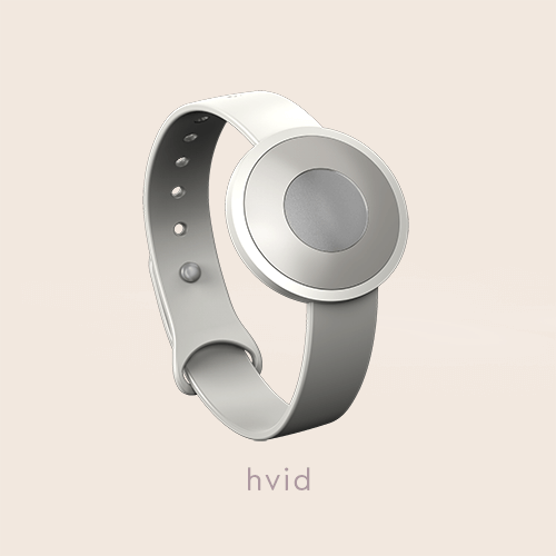 "The .TIBA Aware-able Limited Edition, shown in the white color option, on a beige background with the text ""hvid"" on"