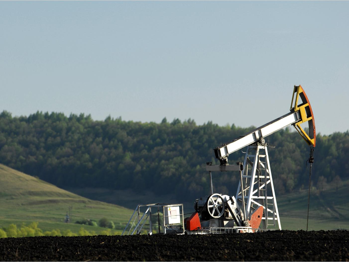 A medium shot of an oil pump jack