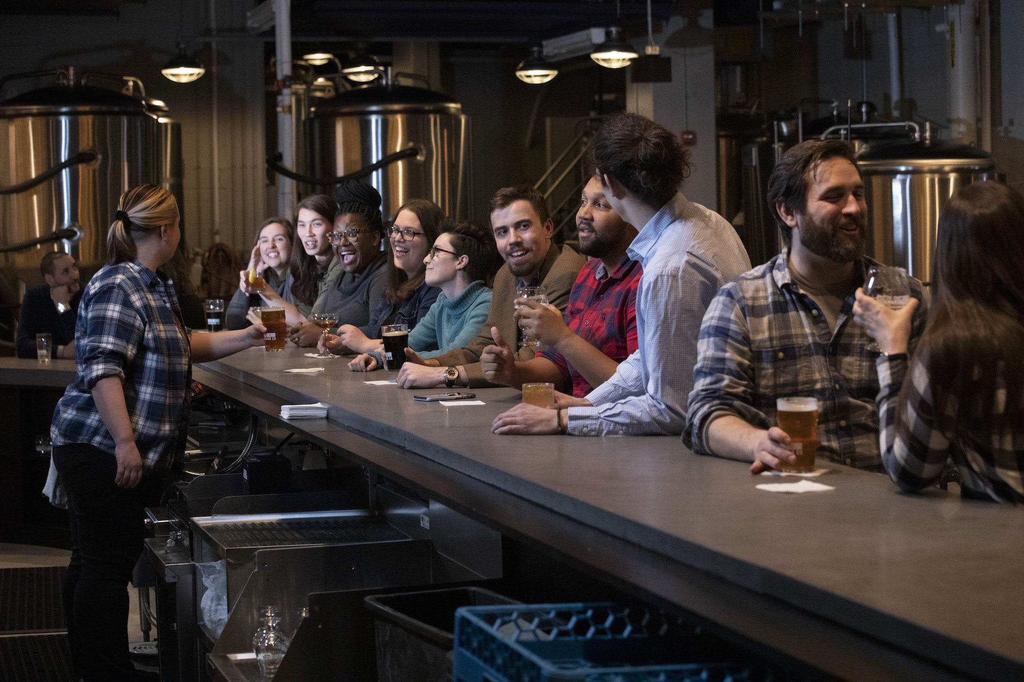 A photo of patrons enjoying drinks and conversations at the bar in Red Bear
