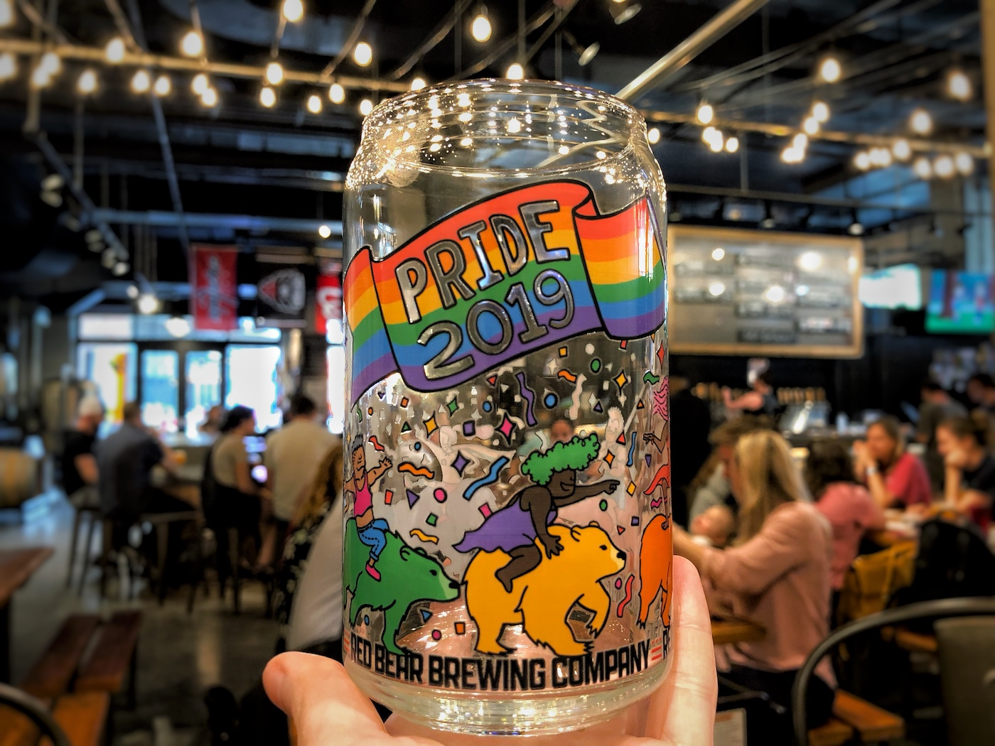 The 2019 Red Bear Pride beer glass with custom illustrations wrapping around it