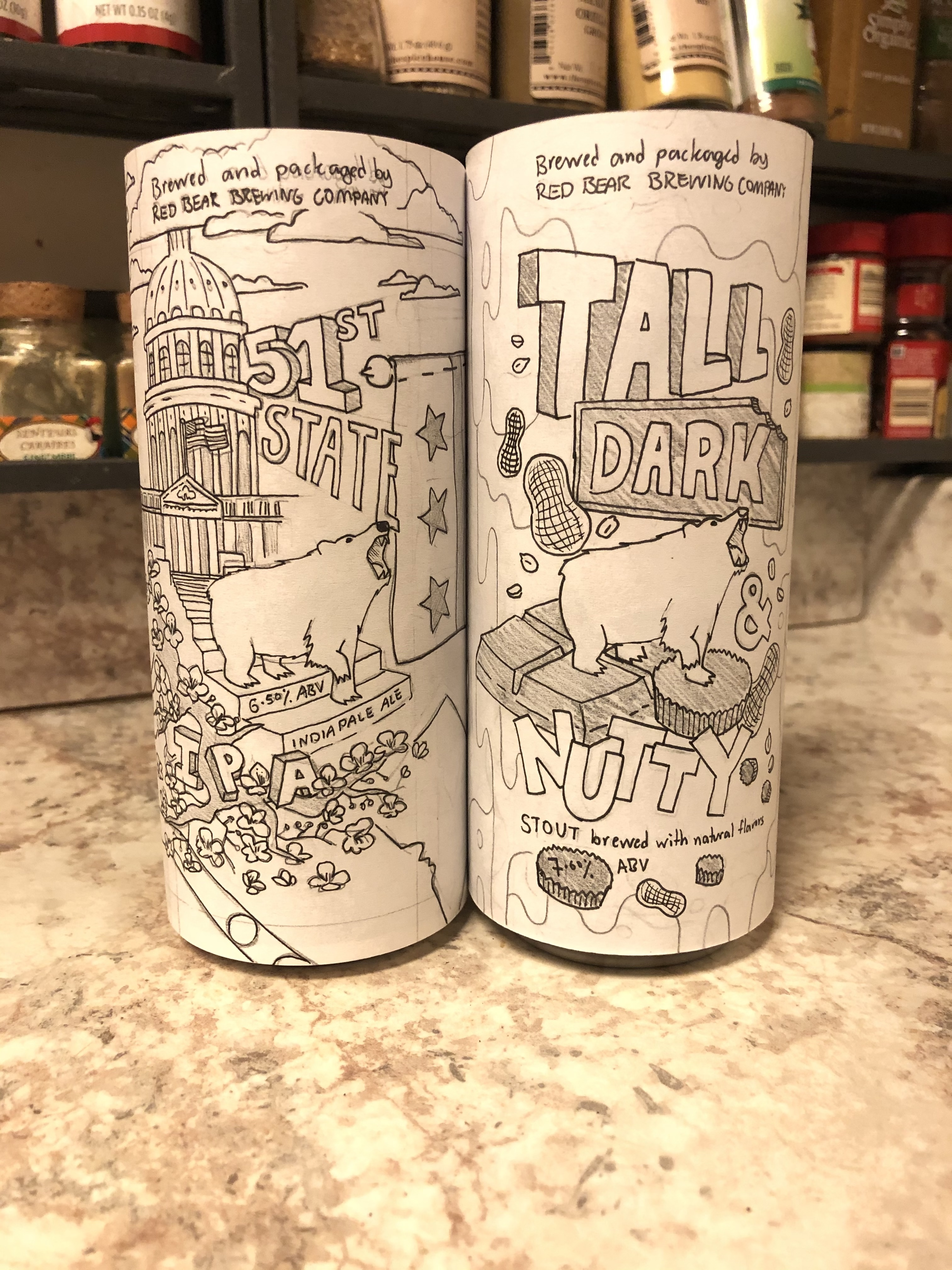 high fidelity sketches wrapped around 16oz soda cans