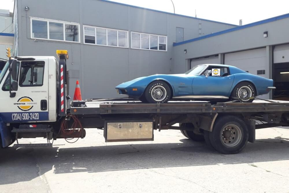 Car on flatbed tow truck