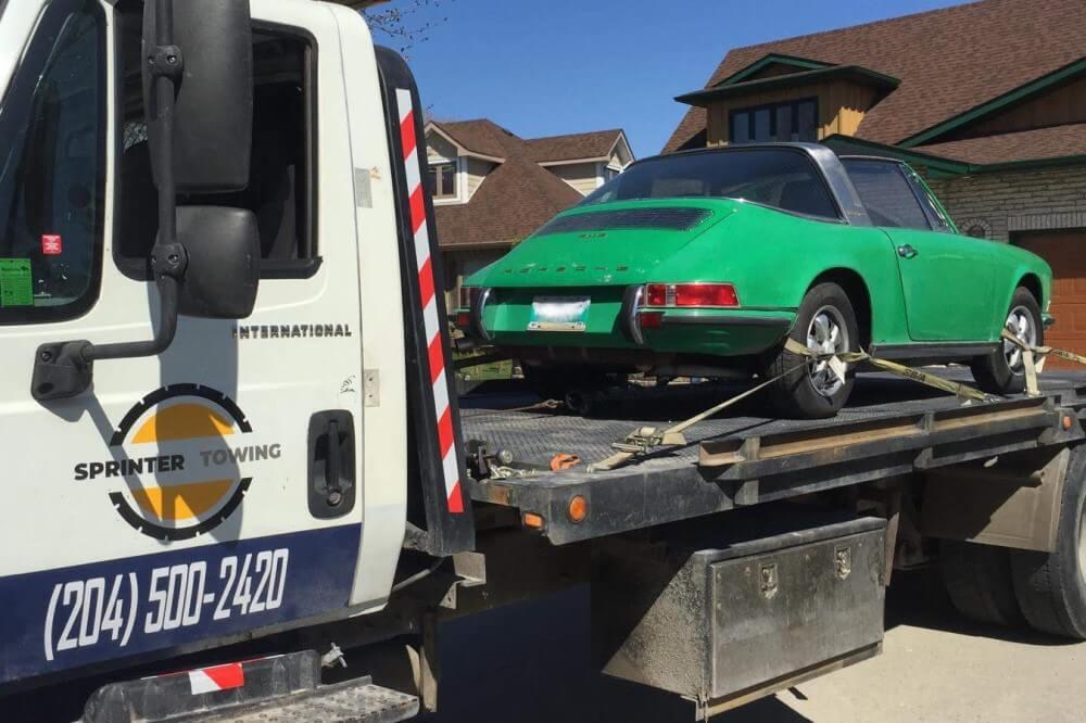 Porsche being towed