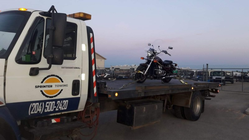 Motorcyle on a flatbed tow truck