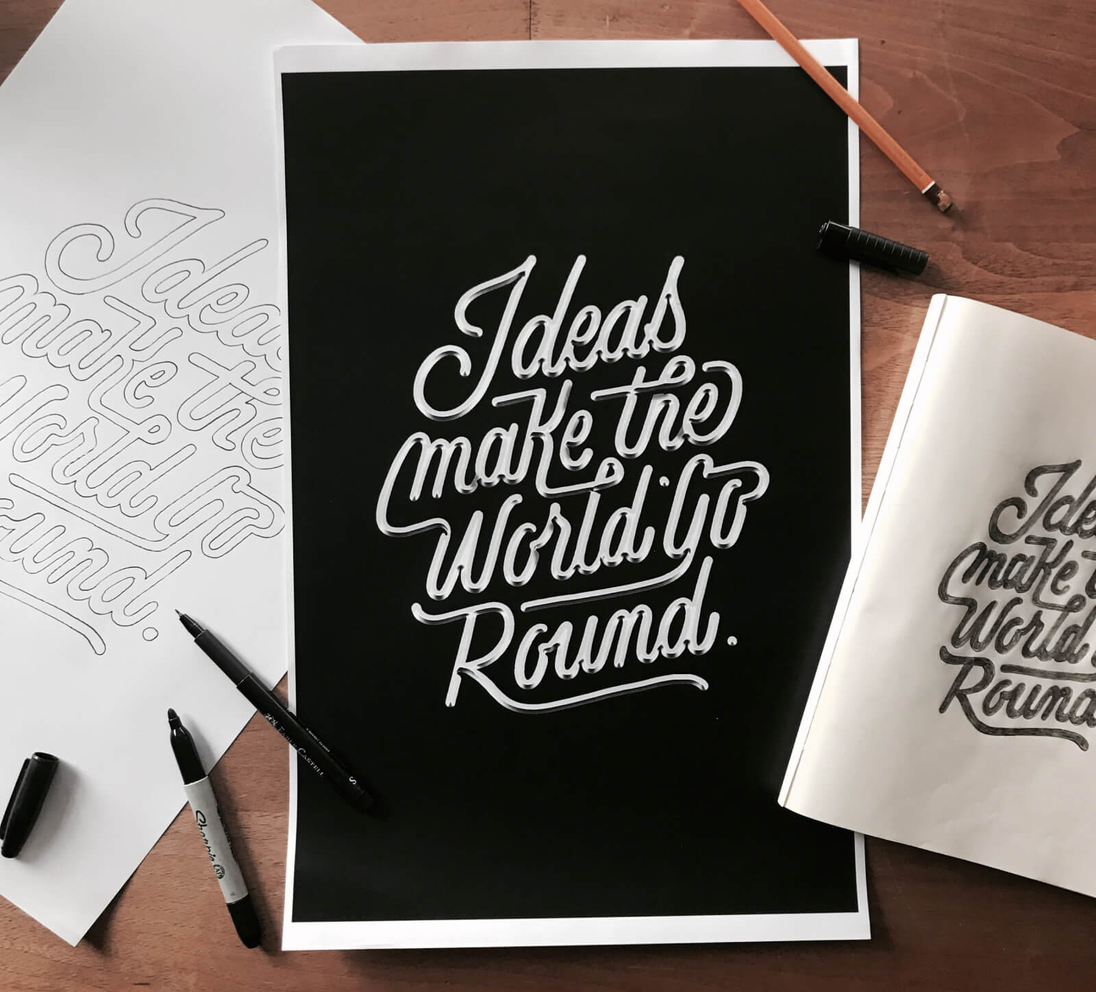 """Ideas make the world go round"" lettering"