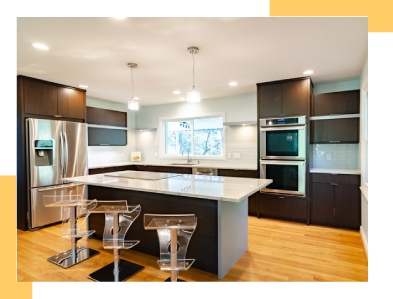 Newly remodeled kitchen with espresso brown cabinets and stainless steel appliances.