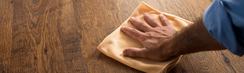 Closeup of hand wiping down a surface