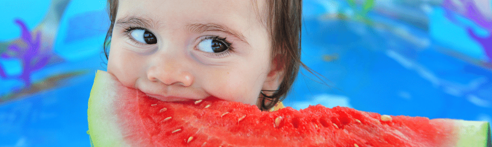 Closeup of child eating watermelon