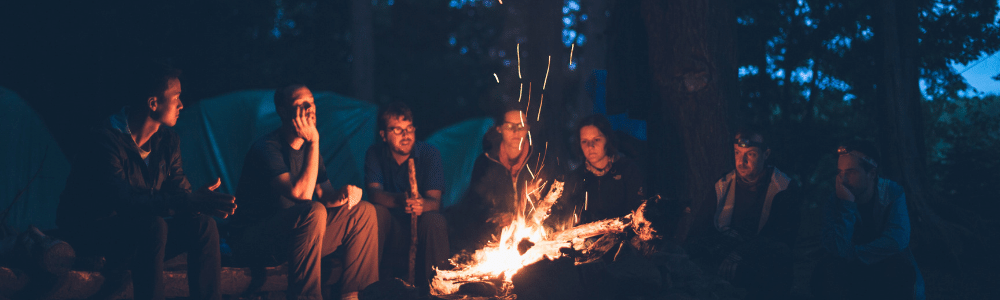 Image of a group around a camp fire
