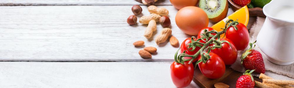 Image of peanuts, eggs, kiwi, tomatoes, and strawberries