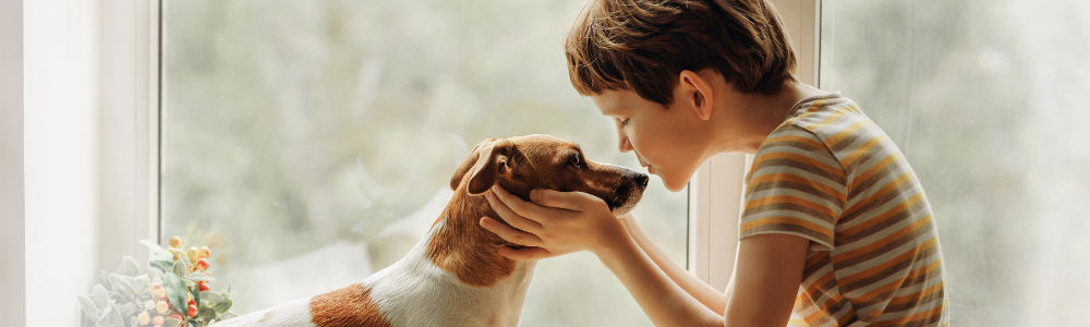 Child and dog snuggling