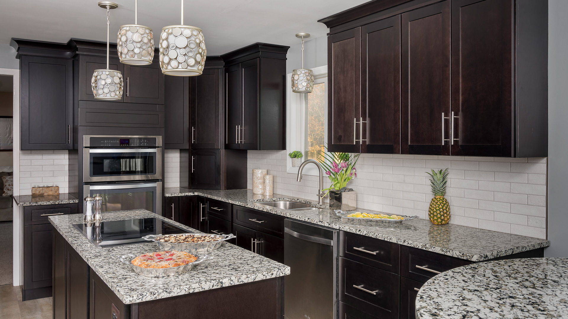 This rich hue of our espresso cabinets gives way to a grand and classic kitchen.