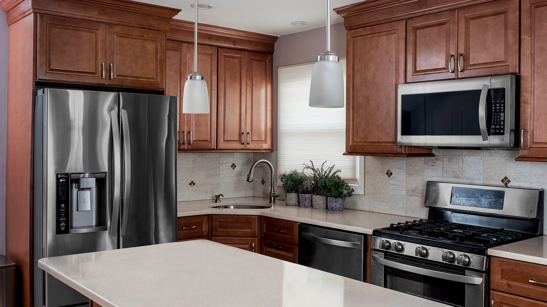 Hallmark pecan cabinets will help design a kitchen that provides a warm, natural connection without making the space dark.